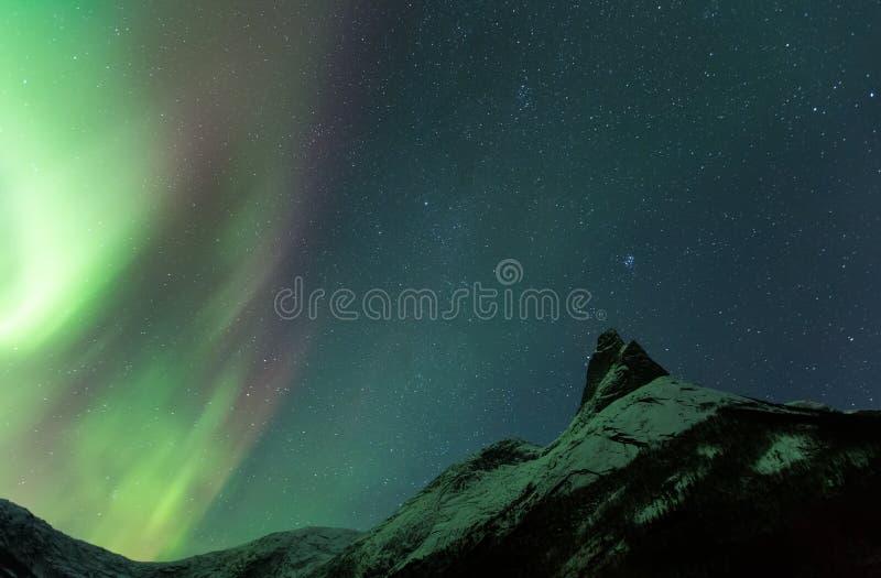 Aurora Borealis Scenery of norway. Aurora Borealis fjords beside a Moundain Peak royalty free stock photo