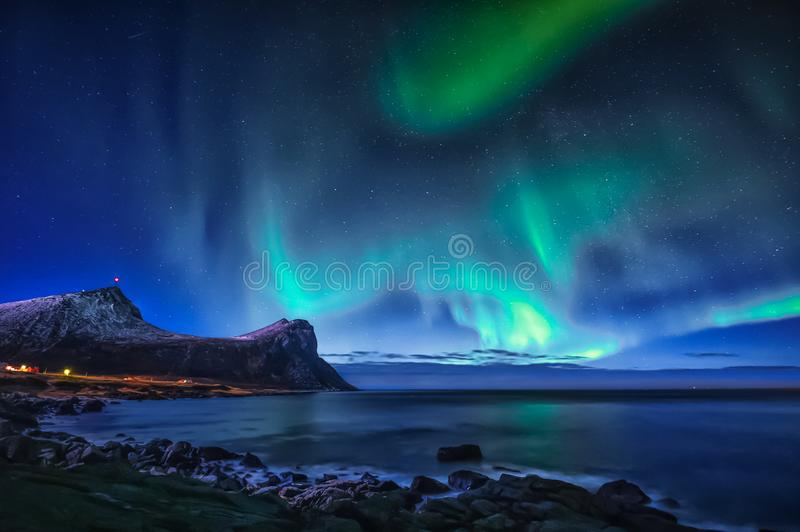 Aurora borealis on sky in Norway. The aurora borealis on the night sky in Northern Norway