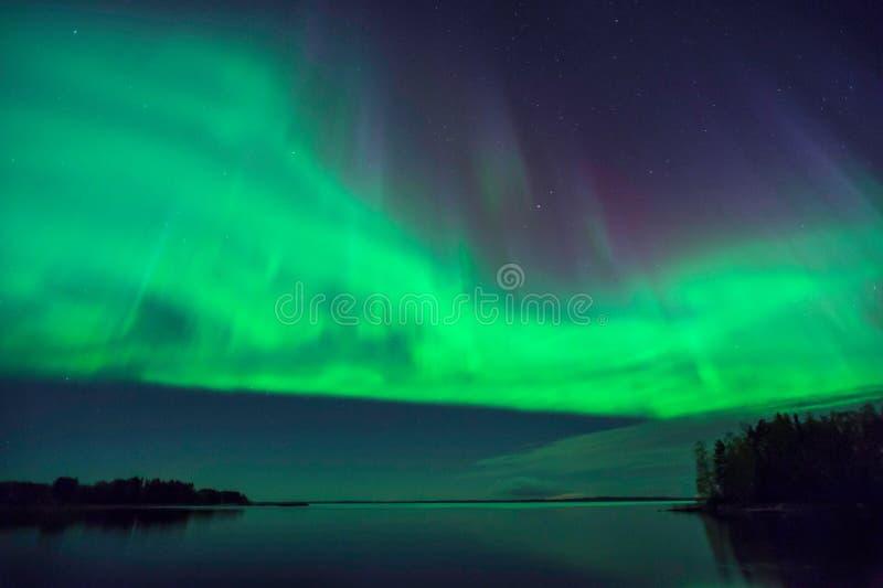 Aurora Borealis, Noordelijke Lichten, in Finland stock afbeelding