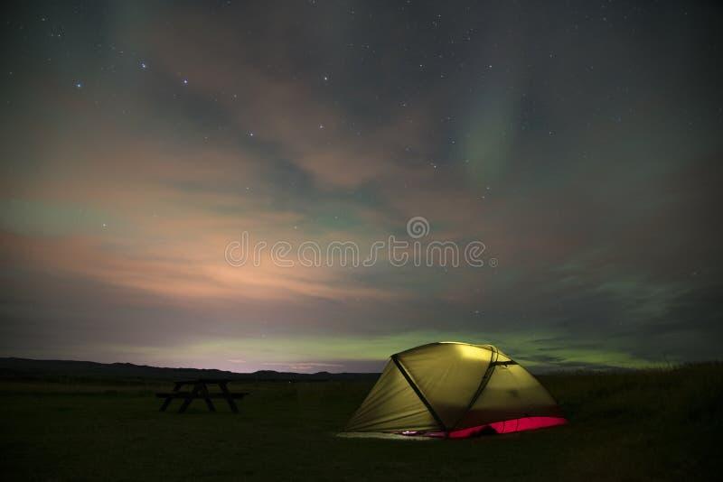 Aurora Borealis Northern Lights Iceland and illuminated tent 4 stock photo