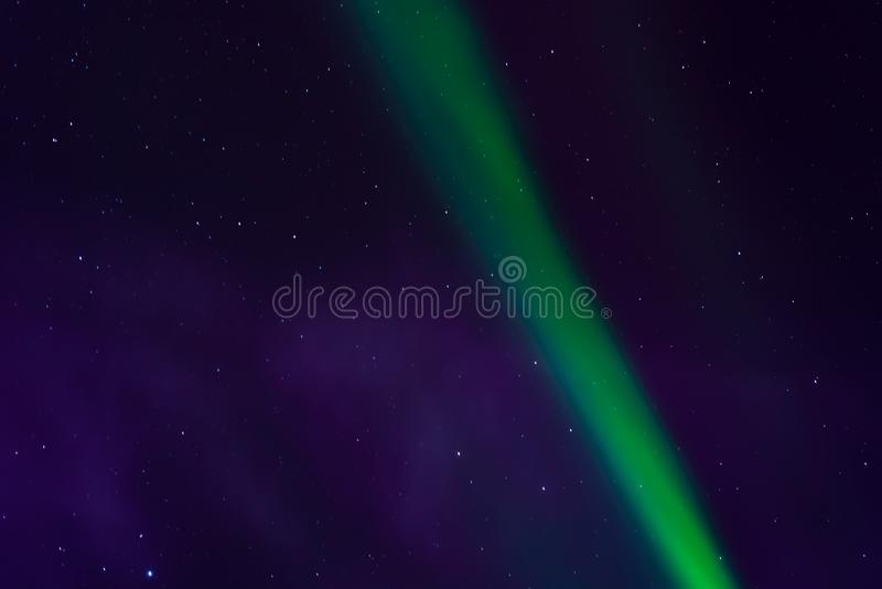 Aurora borealis, northern lights in the night sky with stars royalty free stock images