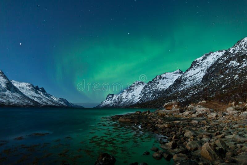 Aurora Borealis (Northern lights) reflecting stock photography