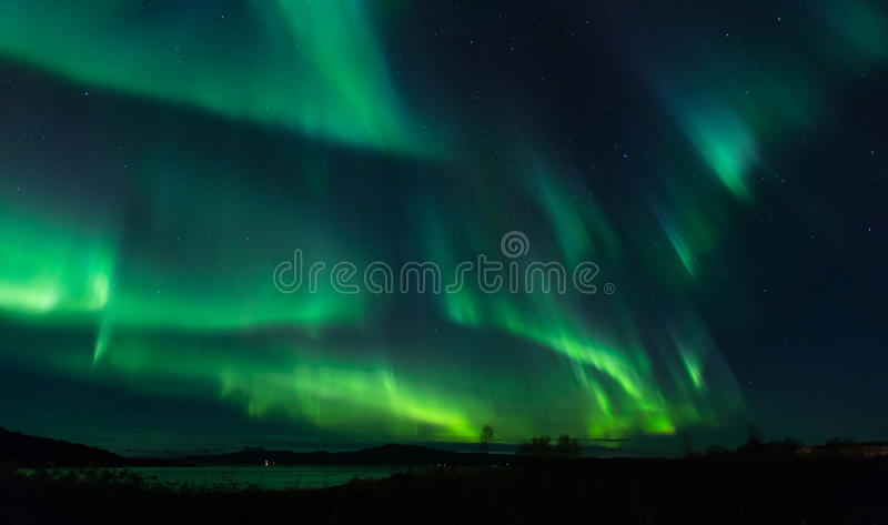 Aurora Borealis. In Northern Norway, green light lights up the scenery stock photography