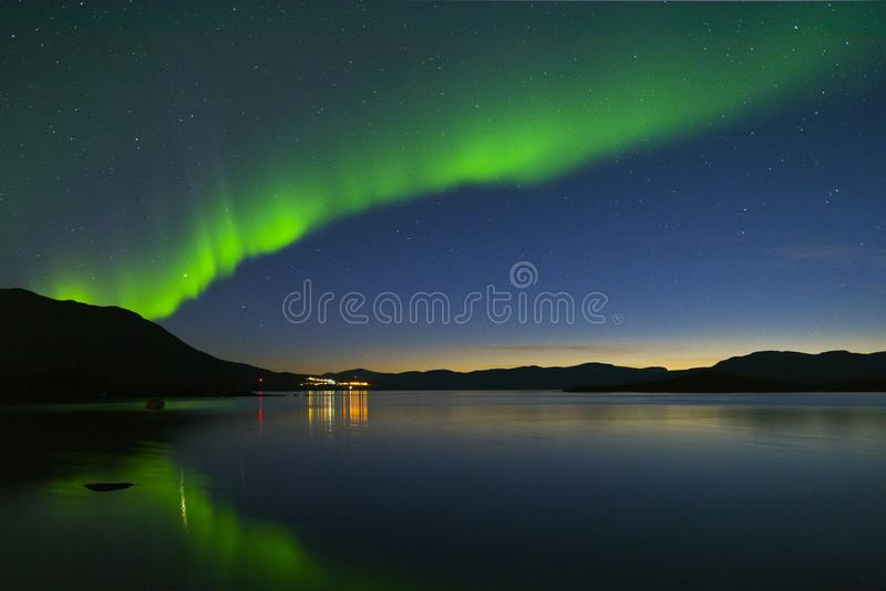 Aurora borealis in Northern Sweden. Landscape with Aurora borealis and Tornetrask lake. Northern Sweden stock images