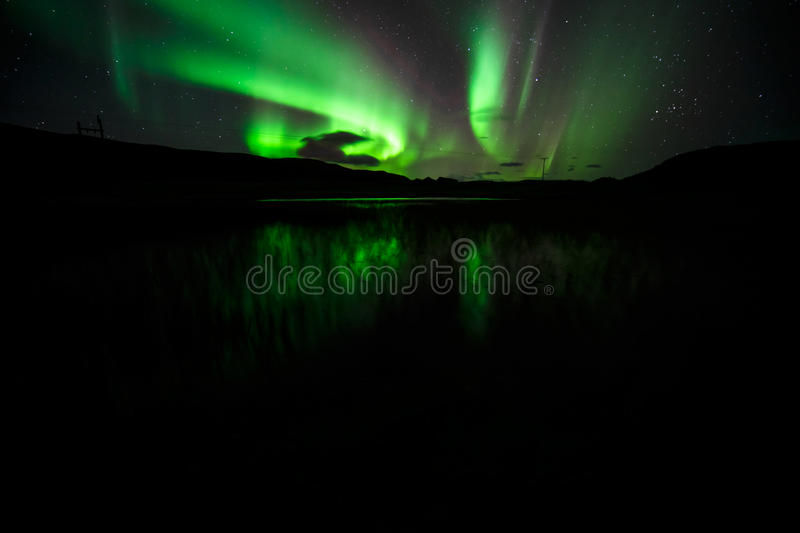 Aurora Borealis. Aurora over Kirkjubaejarklaustur in southern Iceland, long exposure with high iso royalty free stock photography