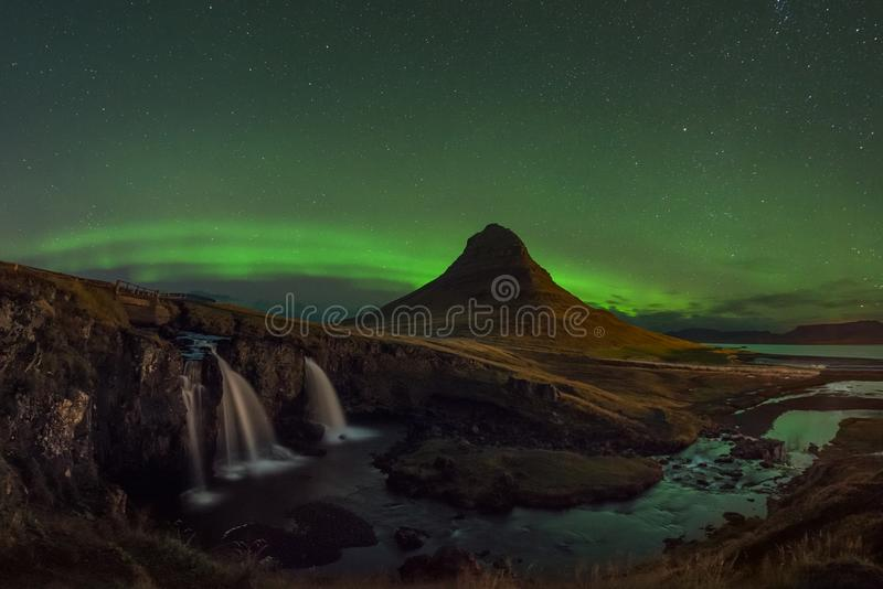 Aurora Borealis over Kirkjufellsfoss and Kirkjufell mountain stock image