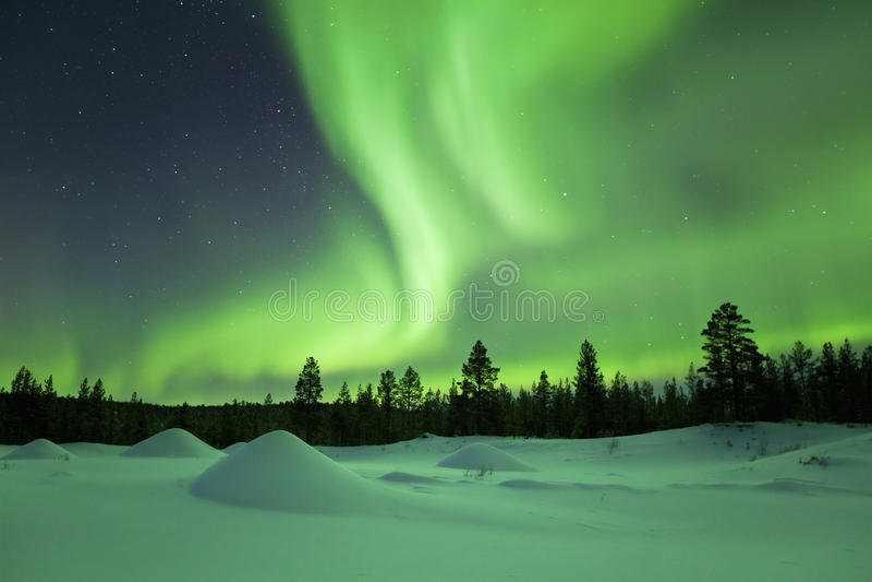 Aurora borealis over winter landscape, Finnish Lapland stock photo
