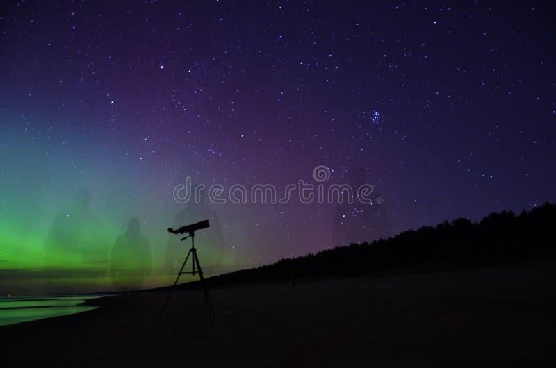 Night sky stars plеiades aurora polar lights telescope observation. Aurora borealis polar lights and Pleiades cluster M45 stars observing stock photography
