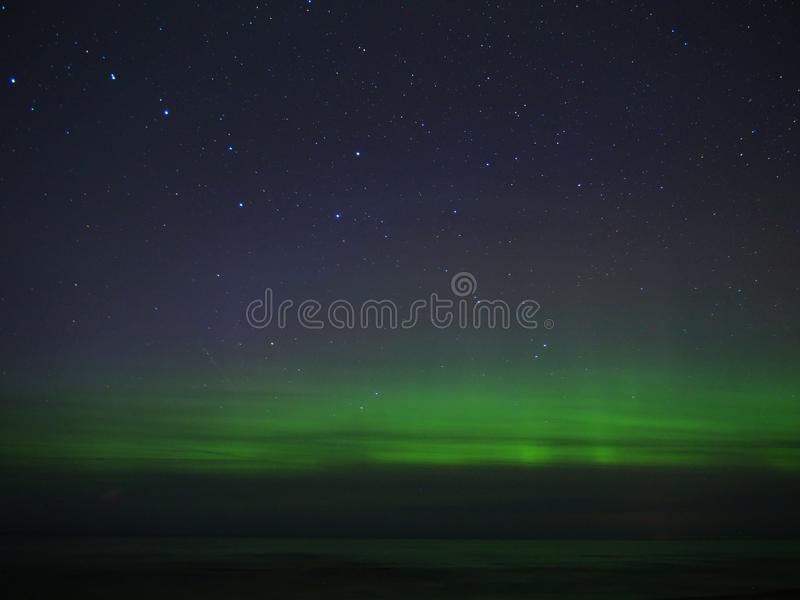 Aurora borealis polar lights and night sky stars royalty free stock images