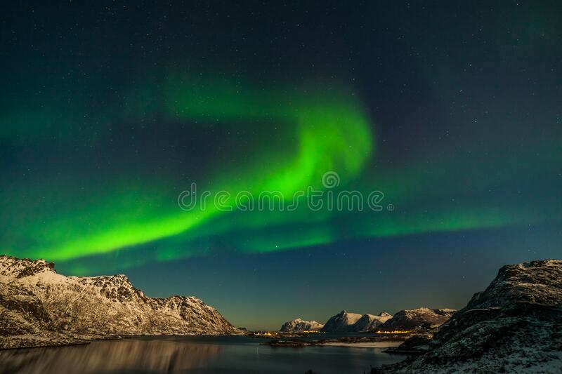Aurora Borealis in Tromso, Norway in front of the Norwegian fjord, winter season, long shutter speed. The polar arctic Northern lights hunting aurora borealis royalty free stock image