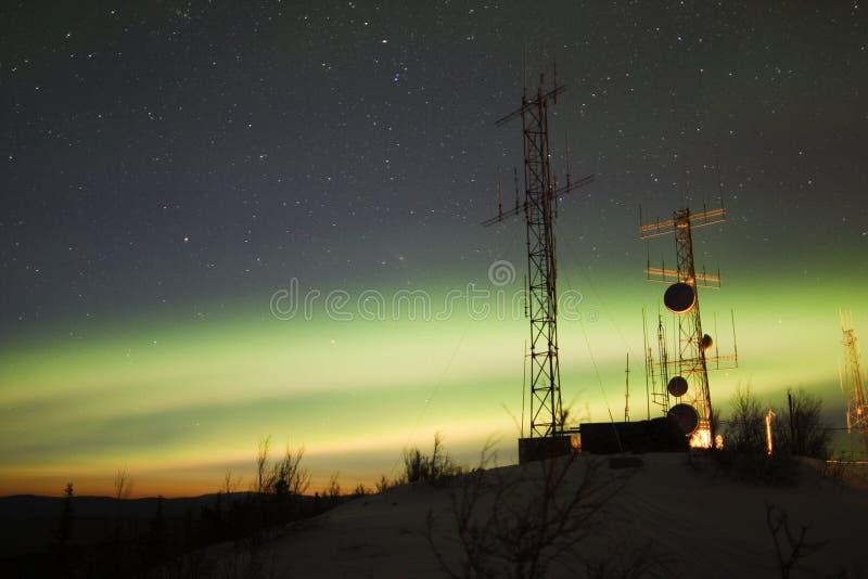 Aurora Borealis and twilight over antenna complex stock photos