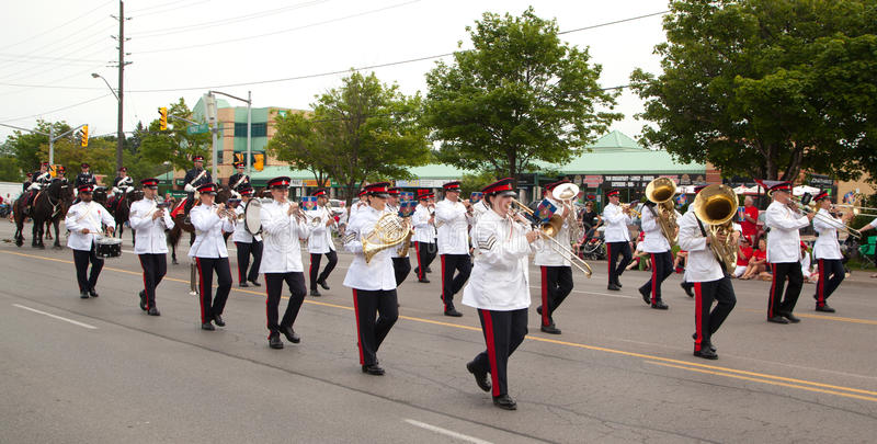 AURORA, CANADA- JULY 1: Marching band in the Canada Day Parade. At part of Young Street in Aurora, Ontario, Canada on July 1, 2013 royalty free stock photos