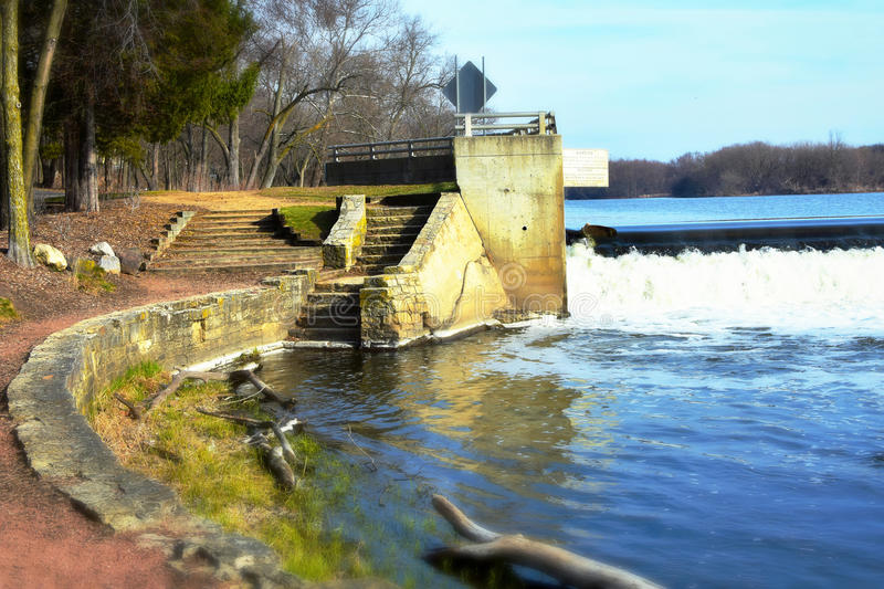 Aurora Dam. The Aurora Dam in Aurora, Illinois. The stairway leading up to the observation deck overlooking the Fox River stock photos