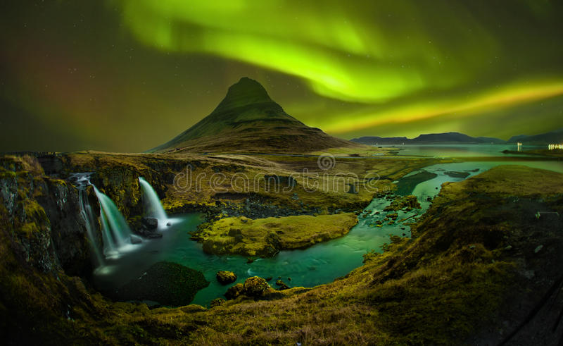 Aurora at Kirkjufell and Waterfall Kirkjufellsfoss, Landmark of stock photos