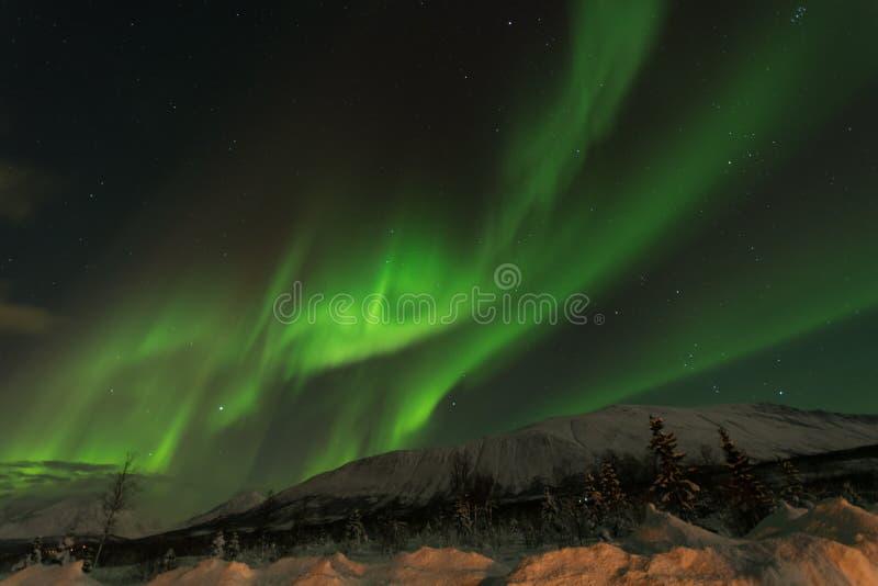 Aurora la tormenta solar en cirlce ártico septentrional foto de archivo libre de regalías
