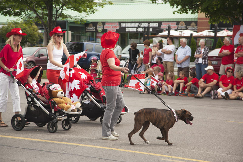 AURORA, ONTARIO, CANADA- JULY 1: Canada Day Parad at part of Young street in Aurora on July 1, 2013. AURORA, CANADA- JULY 1: Unidentified people celebrating a stock images