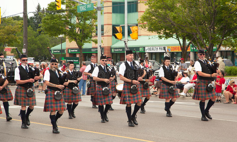 AURORA, ONTARIO, CANADA- JULY 1: Irishmen in their kilt playing their bagpipes during the Canada Day Parade. At part of Young Street in Aurora, Canada on July 1 stock photo