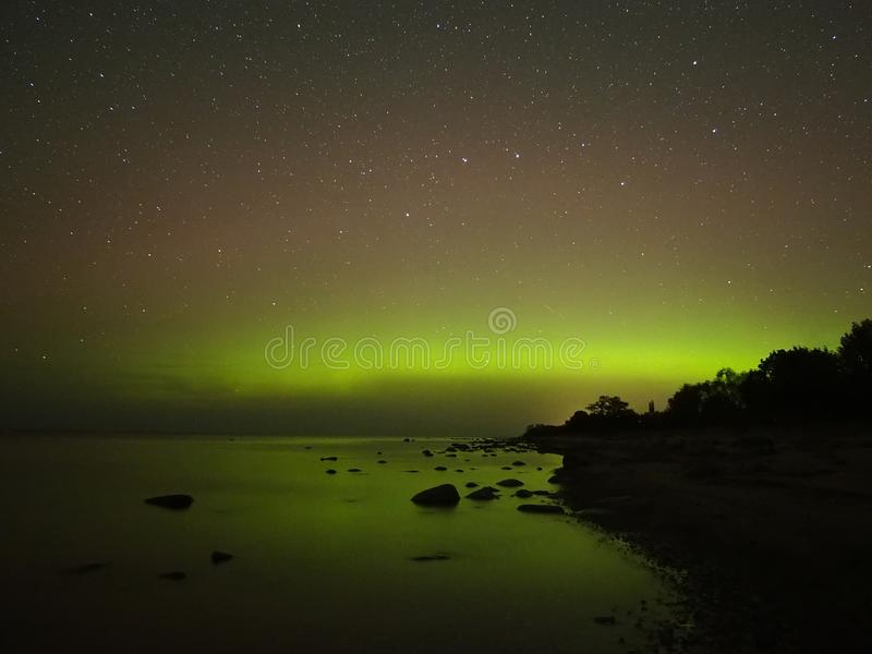 Night sky stars aurora polar lights big dipper constellation observing. Aurora polar lights observing over sea royalty free stock photo