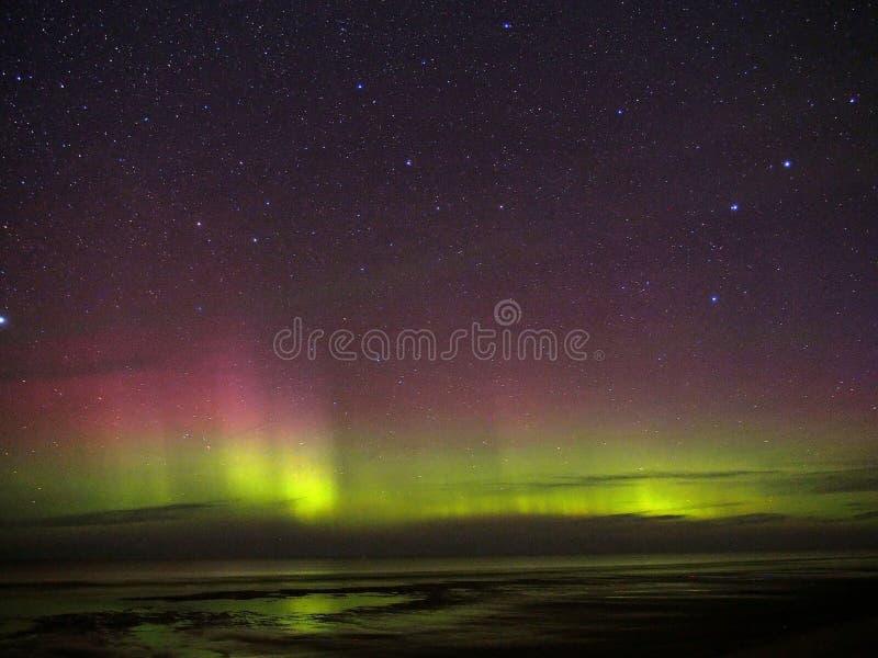 Aurora northern polar lights night sky stars Draco constellation. Aurora polar lights and stars over Baltic sea stock photos