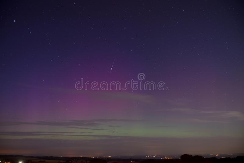 Aurora and shooting star stock images
