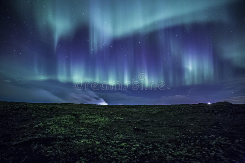 Aurora sopra islandese muscoso Lava Field fotografia stock libera da diritti