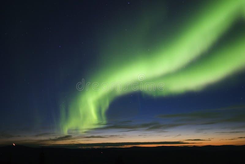 auroral skymning för båge royaltyfria foton