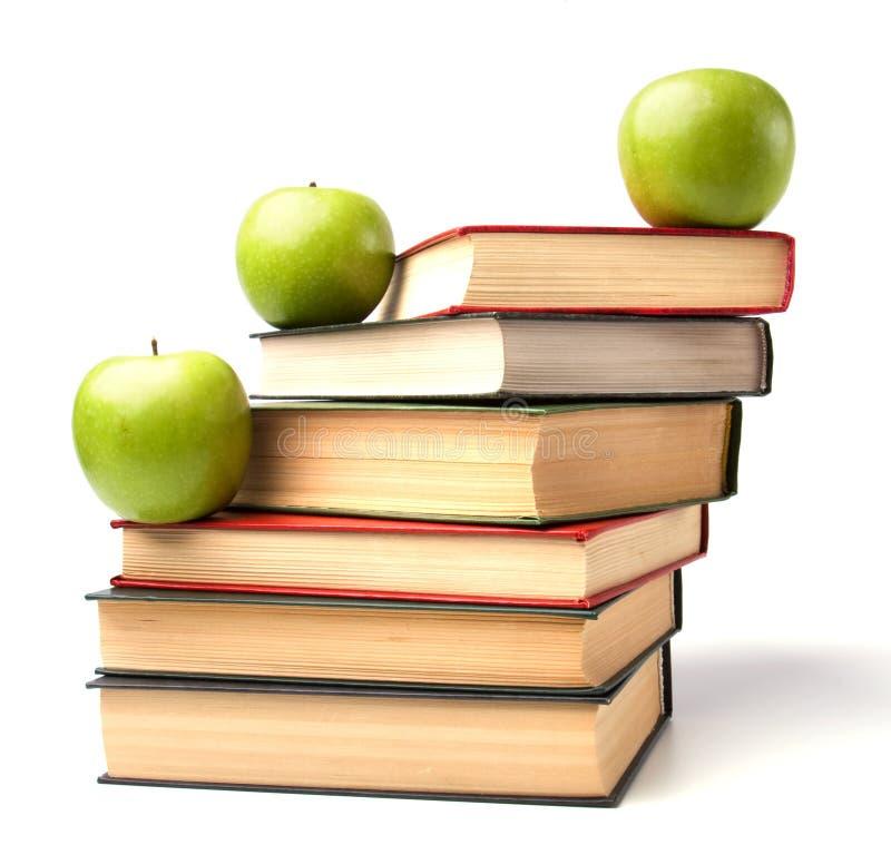 Ausbildungskonzept. Bücher und Äpfel stockfoto