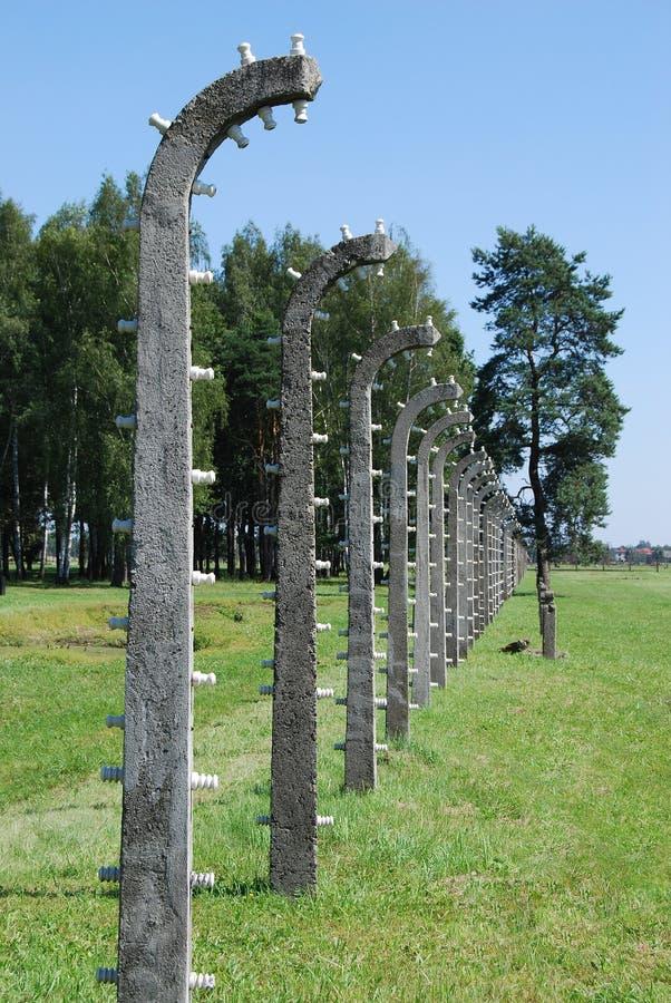 Auschwitz - barbed wire by crematorium IV. Concentration camp Auschwitz - Birkenau in Poland royalty free stock photos