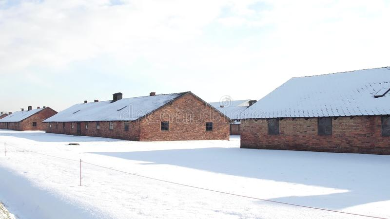 Auschwitz Birkenau barracks in winter. German Nazi concentration and extermination camp. Auschwitz Birkenau barracks in winter. Nazi concentration and stock image