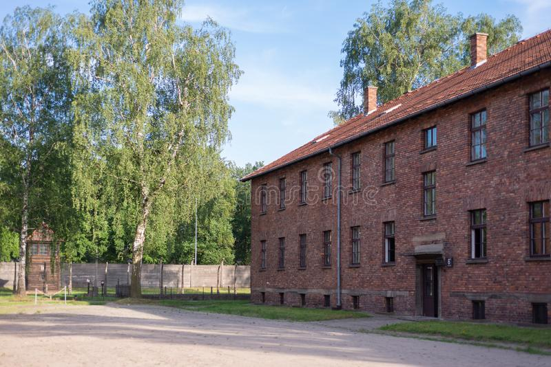 AUSCHWITZ-BIRKENAU CONCENTRATION CAMP, POLAND - JUNE, 2017: Block of houses in concentration camp in Auschwitz, Poland. It was the stock photography