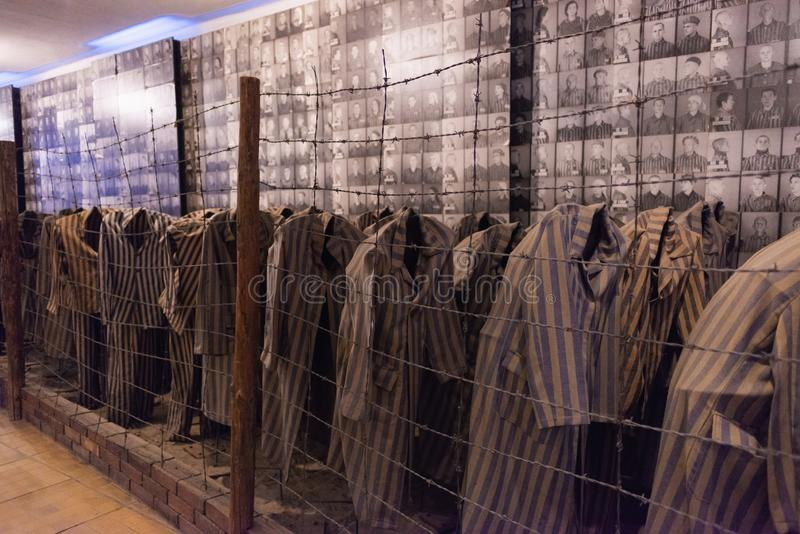 AUSCHWITZ-BIRKENAU CONCENTRATION CAMP, POLAND - JUNE, 2017: Clothing prisoners concentration camps in which were destroyed Jews. And prisoners of war during royalty free stock photography