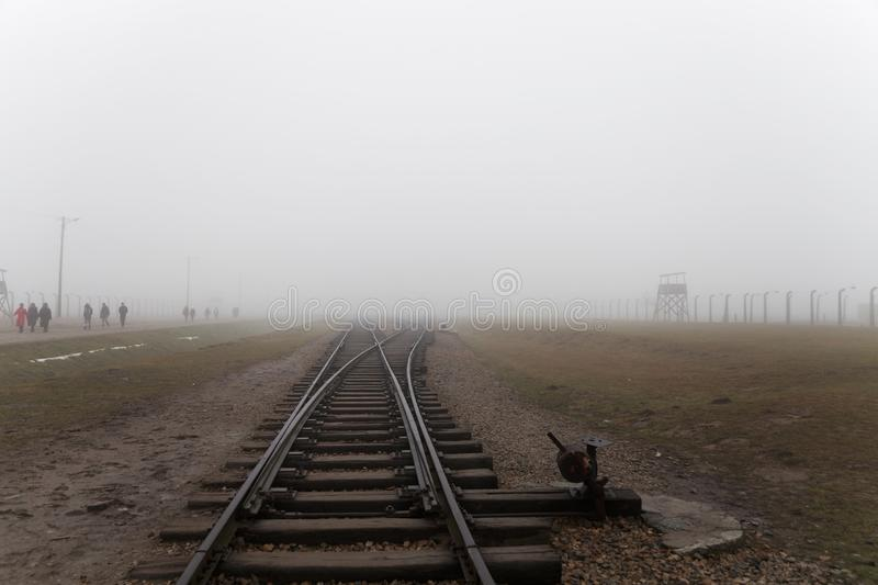 Auschwitz-Birkenau concentration camp. The tracks in the Jewish extermination camp. German death camp in OÅ›wiÄ™cim. Barbed wire. Auschwitz-Birkenau royalty free stock image