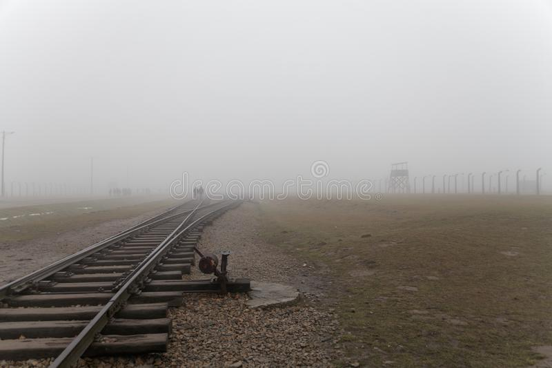Auschwitz-Birkenau concentration camp. The tracks in the Jewish extermination camp. German death camp in OÅ›wiÄ™cim. Barbed wire. Auschwitz-Birkenau royalty free stock photo