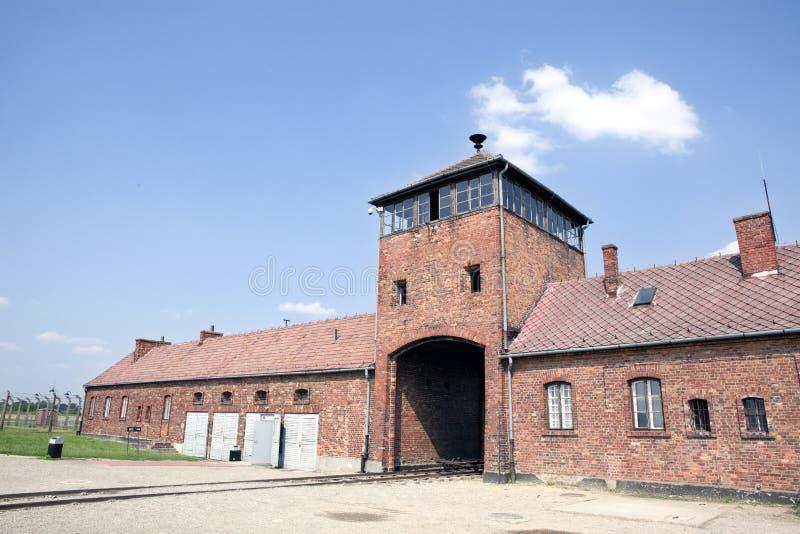 Auschwitz Birkenau main entrance with railways. Auschwitz Birkenau main control tower in the entrance with railways leading to it. Auschwitz concentration camp stock image
