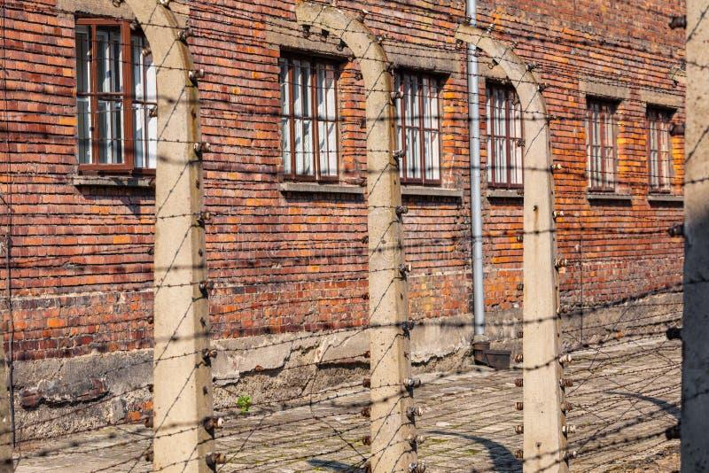 AUSCHWITZ-BIRKENAU, POLAND - AUGUST 12, 2019: Holocaust Memorial Museum. Separation barbed wire in prison camps. Part of Auschwitz. Birkenau Concentration Camp stock photos