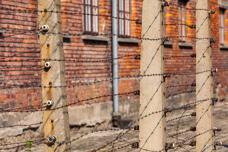 AUSCHWITZ-BIRKENAU, POLAND - AUGUST 12, 2019: Holocaust Memorial Museum. Separation barbed wire in prison camps. Part of Auschwitz. Birkenau Concentration Camp stock photography