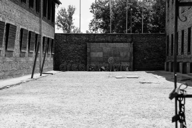Auschwitz-Birkenau, Poland - June 27, 2019 German concentration camp Auschwitz. View of the ,,wall of death. Auschwitz-Birkenau, Poland - June 27, 2019 ,,Wall of stock image