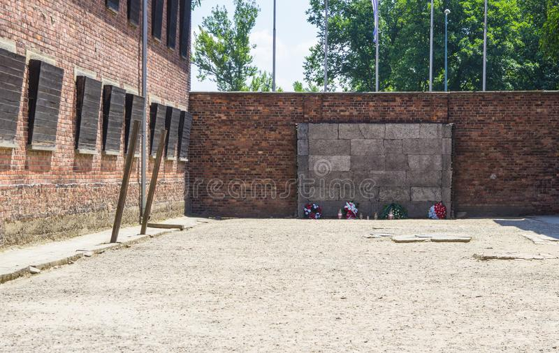 Auschwitz-Birkenau, Poland - June 27, 2019 German concentration camp Auschwitz. View of the ,,wall of death. Auschwitz-Birkenau, Poland - June 27, 2019 ,,Wall of royalty free stock photography