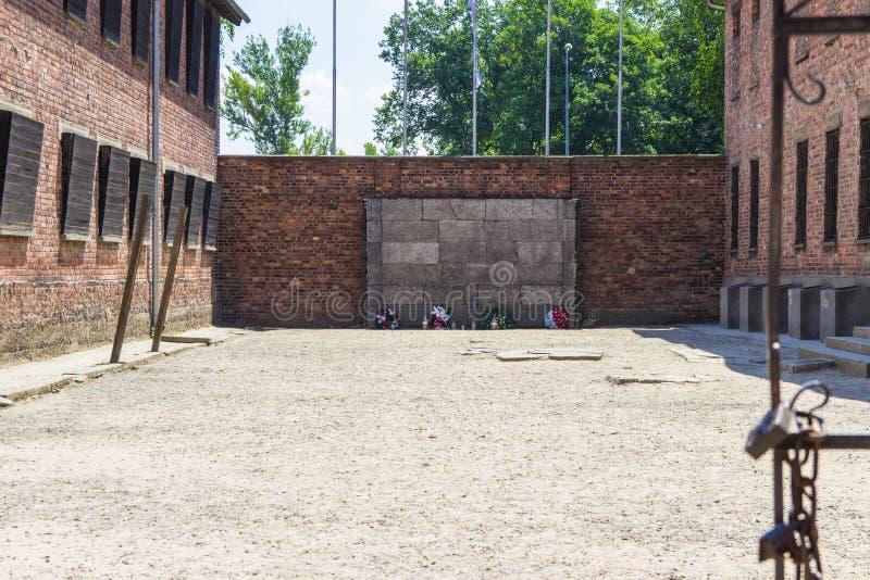 Auschwitz-Birkenau, Poland - June 27, 2019 German concentration camp Auschwitz. View of the ,,wall of death. Auschwitz-Birkenau, Poland - June 27, 2019 ,,Wall of stock photos