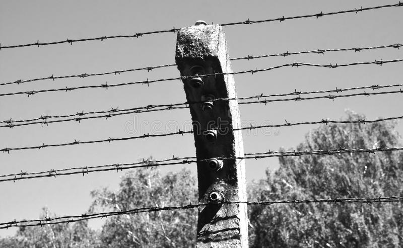 Auschwitz concentration camp fence. AUSCHWITZ BIRKENAU POLAND 09 17 17: Auschwitz concentration camp fence was a network of German Nazi concentration camps and royalty free stock images