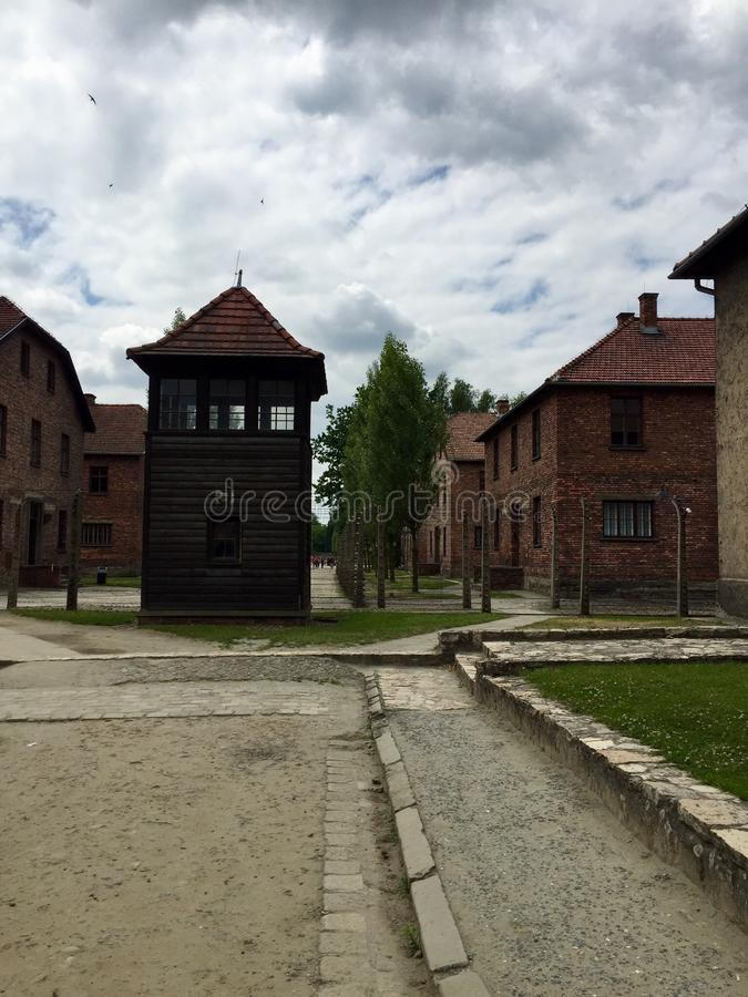 Auschwitz concentration camp. Guard tower and surrounding buildings at Auschwitz concentration camp in the summer stock image