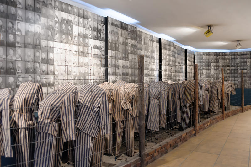 Auschwitz I - Birkenau prisoner photos. OSWIECIM, POLAND - JULY 3, 2009: Auschwitz I - Birkenau display in Block 15 of prisoners' striped uniforms and photos of royalty free stock photo