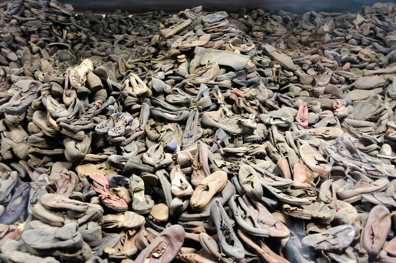 Auschwitz I - Birkenau shoes. OSWIECIM, POLAND - JULY 3, 2009: Auschwitz I - Birkenau, shoes collected from prisoners exhibited in Block 5 as Material Evidence royalty free stock photography