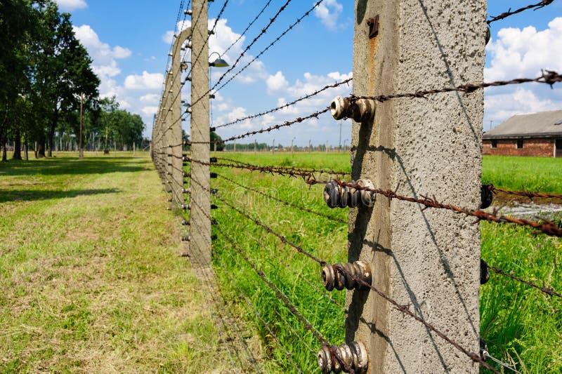 Auschwitz II - Birkenau electrified fence. Auschwitz II - Birkenau, aspect and closeup of the electrified barbed wire fence stock image