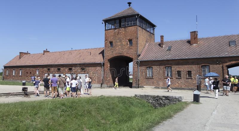 Auschwitz II - Birkenau entrance with visitors on the July 6th, 2015 - Krakow, Poland stock images