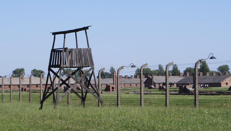 Auschwitz II - Birkenau, guard station and barbed wire fence - July 6th, 2015 - Krakow, Poland royalty free stock photos