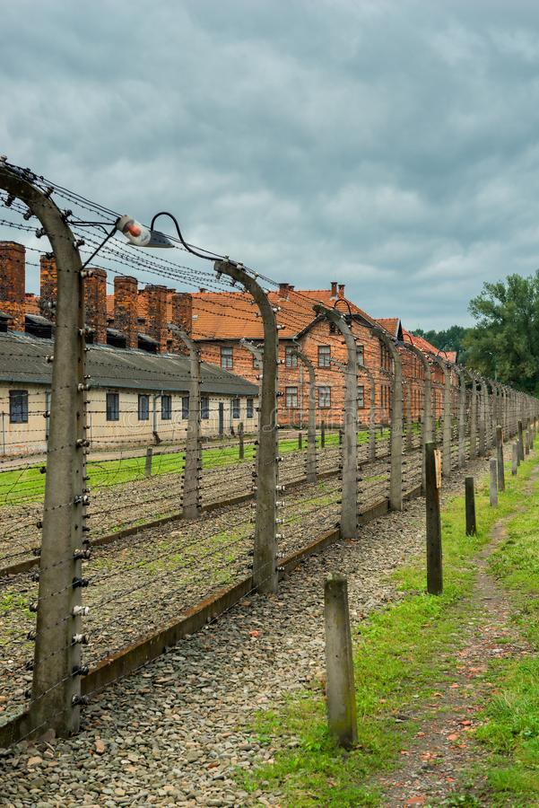 Auschwitz, Poland - August 12, 2017: death line in concentration camp wire with high voltage. The death camp of Auschwitz Auschwitz 1940-1945. About 1.4 million royalty free stock images