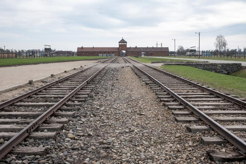 The main entrance to Auschwitz Birkenau Nazi Concentration Camp showing the train tracks used to bring Jews to their death. Auschwitz, Poland. The main entrance royalty free stock photo