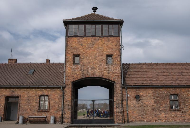 Photo showing the security tower at the entrance to Auschwitz Birkenau concentration camp, Nazi death camp dating back to WW2. Auschwitz, Poland. Photo showing stock images