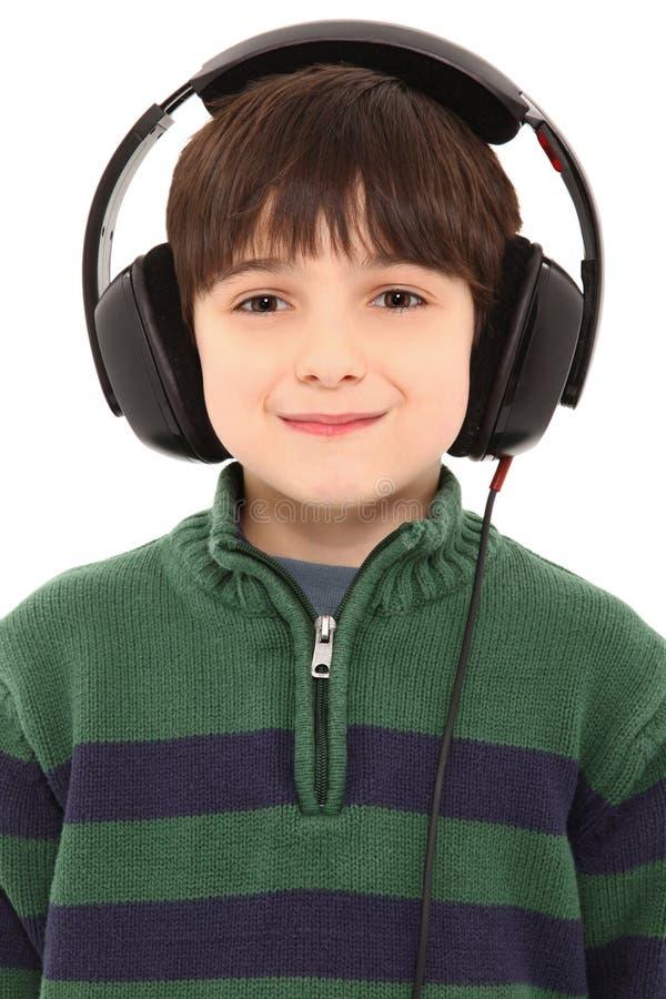 Auscultadores de sorriso da criança com trajeto de grampeamento foto de stock royalty free